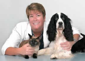 Dr Mary Fondren, veterinarian, with her cat Frankie and Sami her springer spaniel
